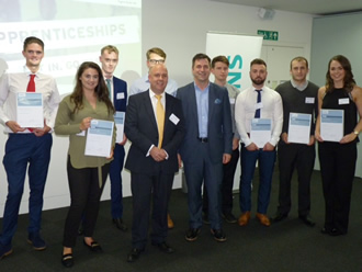 Young apprentices graduate from global firm