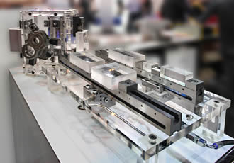Hydraulic version of low-profile clamping system enables automation
